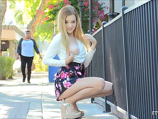 Spectacular blonde teen babe Winter flashes her obese tits with regard to public