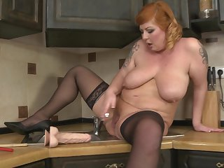 Chubby adult amateur Alex stuffs her pussy far toys in a catch kitchen