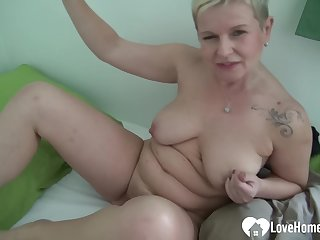 Sexually Attractive golden hair babe uses a dildo on her vagina