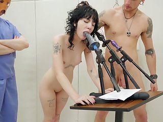 Tattooed chick gives a blowjob and rimjob to a duo of unusual dudes in masks