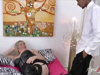 Busty blonde mature gets obese Negro cock deep inside her vagina