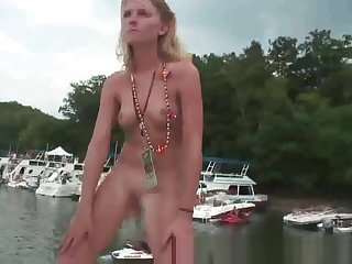 Group of drunk party girls blinking less on a boat