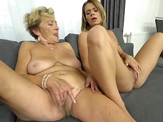 Blonde belle in lesbo action with a granny