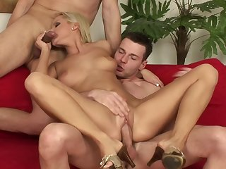 Number one wife Sunny A. on the brush knees pleasuring two pulsating dicks