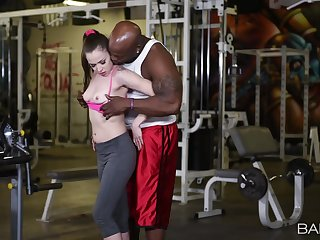 Muscular inky man fucks this fit babe down at the gym