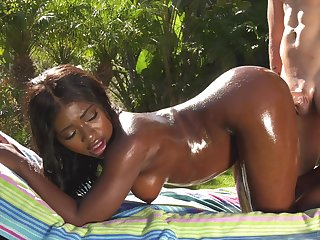 White man gives oiled up ebony babe Noemie Bilas a fantastic racing bang