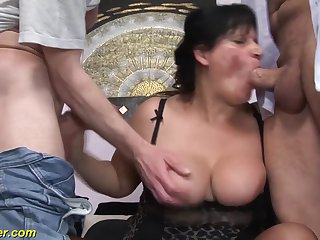 Prexy dark-haired lady gets double fucked on a comfy couch