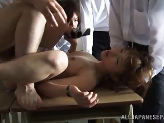 Hardcore gangbang not susceptible the table with clothed Japanese hottie