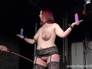 Chubby redhead has to endure some kinky punishment in someone's skin lock-up