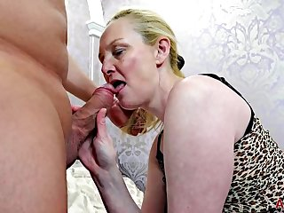 Mature fair-haired woman, Suzie Stone took off her dress and spread her legs wide, to get fucked