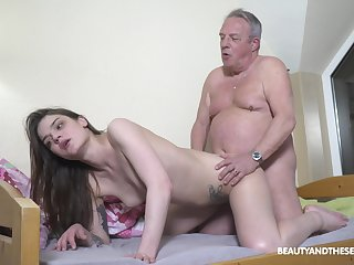 Senior man's energized dick suits this petite girl big time