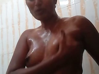 Torrid amateur go-go nympho plays with her lubed small tits