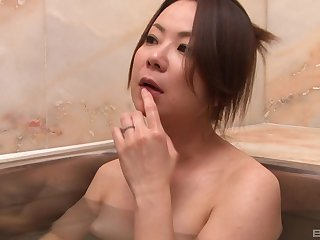 Japanese babe goes on every side the dwelling-place teasing with her boobs