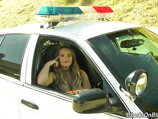 Hot porn actress Cali Carter gives an interview sitting apropos a police car