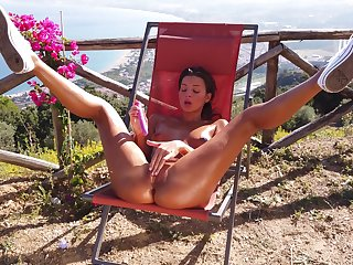 Sun-kissed Maria spreads her legs outside to dip fingers in her hot to trot twat