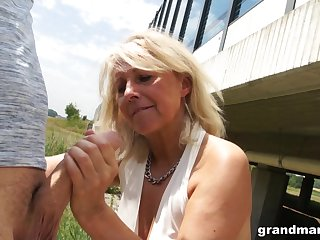 Slutty granny gives a blowjob in public and shows wet white In US breeks