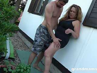 Obsessed thither sex granny enjoys sneaky sex thither young gardener