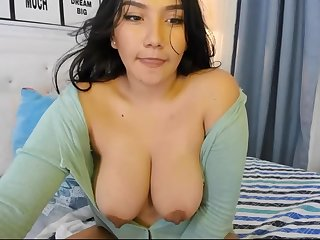 Hot Latina babe flashes big tits at bottom webcam