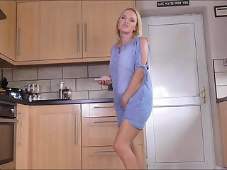 Sexy blonde pissing at the kitchen