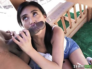 Cute Asian pigtailed brunette Ember Pushover is so good to hand sucking big cock