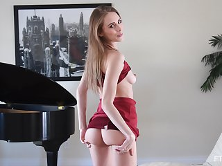 Slender cutie Kyler takes off her red dress to sketch her pussy