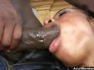 Oiled ebony model Pleasure Bunny sucks a large dick on a catch sofa