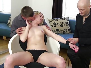 Insane how the young blonde handles both dicks