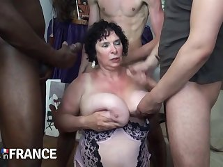 Sex-mad granny fucked unconnected with two strong young guys