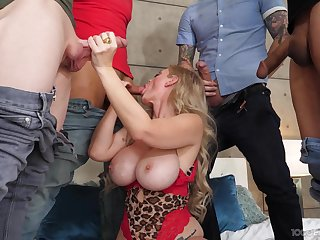 Gang bang shows the busty cougar the real pleasure of swallowing